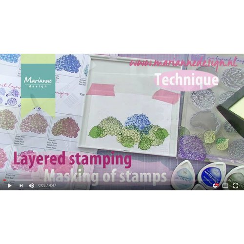 Une démonstration dans cette vidéo avec un timbre en couches de Tiny Harts de Marianne Design!