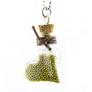 Embellishments / Verzierungen 2 mini glass bottles with wedge and hanger.