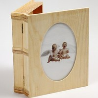 Wooden box in book form with passe-partout in the lid.