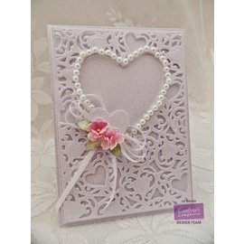 Die'sire Punching and embossing template: Filigree Heart frame