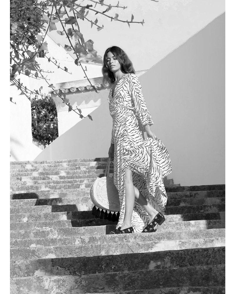 Izuskan  Venice beach, long wrap dress in white with light grey zebra print in 100 % viscose.