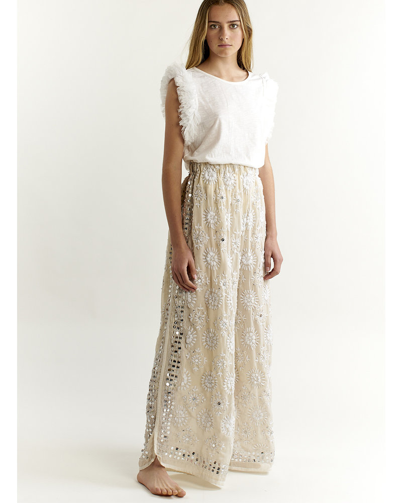 Izuskan Long pants handembroidered with silver sequins .