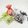 3 theebloemen in organza zakje met strik