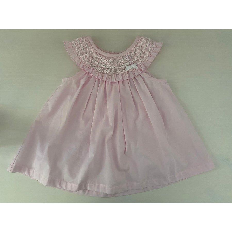Roze jurk met bewerkte kraag en strikje