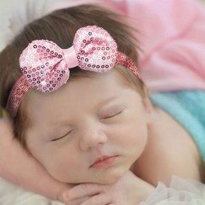 Baby haarbandje strik met glitterpailletjes (lichtroze)