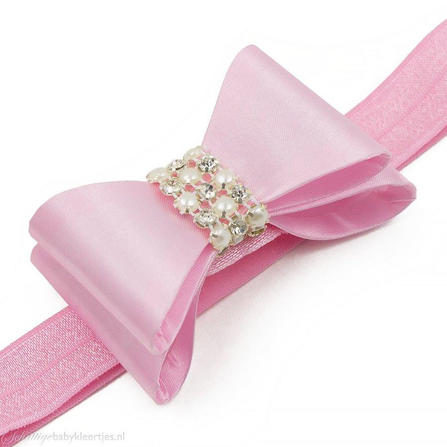 Haarbandje PVC strik met strass en parels (lichtroze)