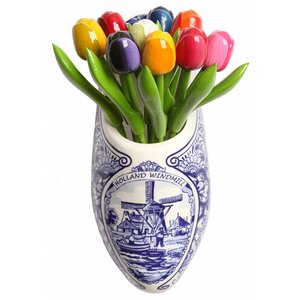 Typisch Hollands Delft blue wooden shoe tulips in wooden shoe -