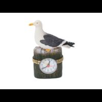 Typisch Hollands Gull on beach pole with clock