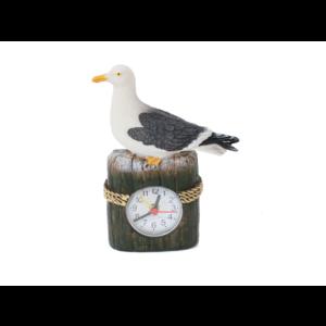 Typisch Hollands Möwe am Strandmast mit Uhr