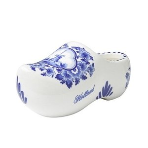 Delft blue clog with traditional mill landscape