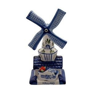 Typisch Hollands Delft blue windmill with wooden shoe and colored tulips