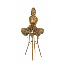 Lady with naughty look on bar stool