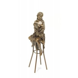 Topless lady on bar stool