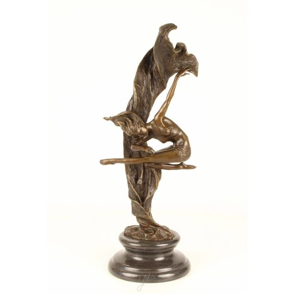 Bronze sculpture of a twirling dancer