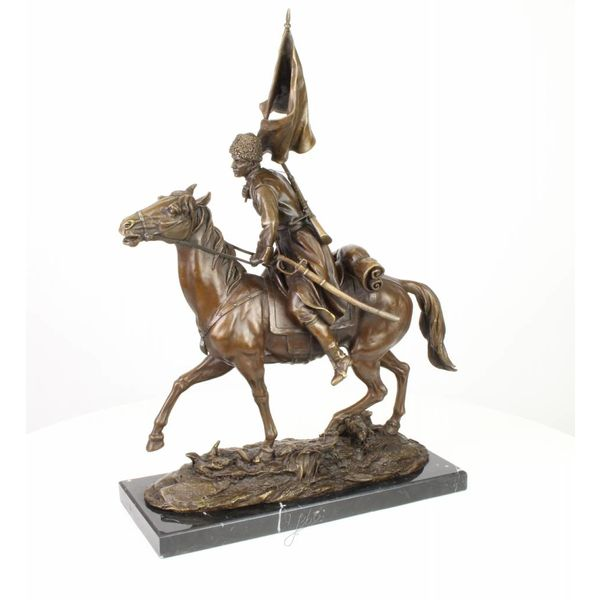 Bronze sculpture of an armed Cossack on horseback
