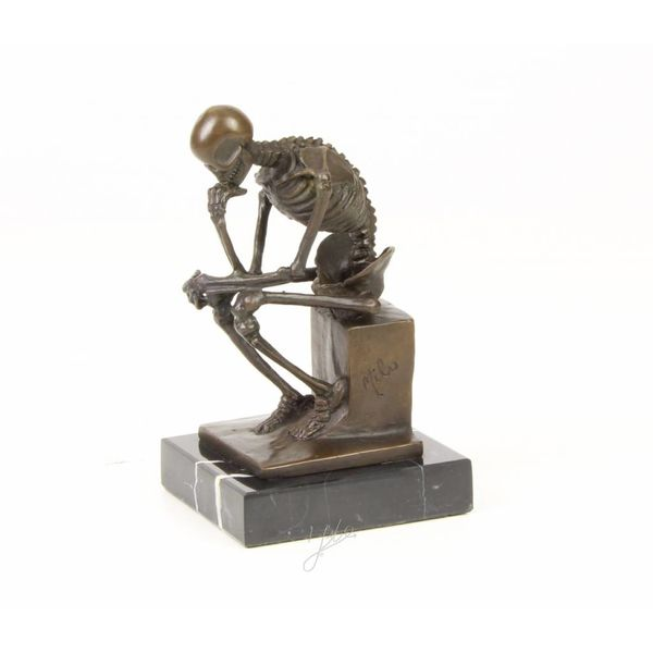 Bronze sculpture of a thinking skeleton