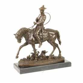 A huntsman on horseback