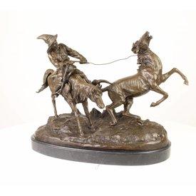 Bronzen beeld van cowboy scene
