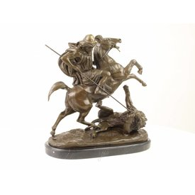A BRONZE GROUP OF AN ARAB RIDER KILLING A LION