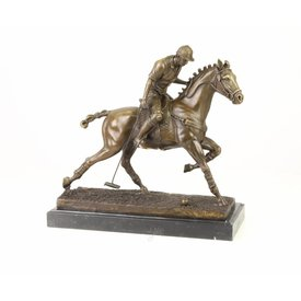 A BRONZE SCULPTURE OF A POLO PLAYER
