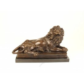 A BRONZE SCULPTURE OF A RECLINING LION