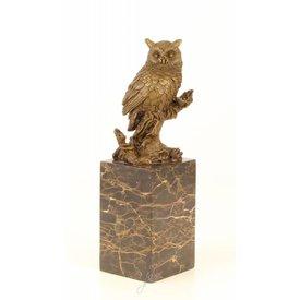 A BRONZE SCULPTURE OF A LONG-EARED OWL