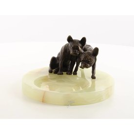 An ashtray with two pugs