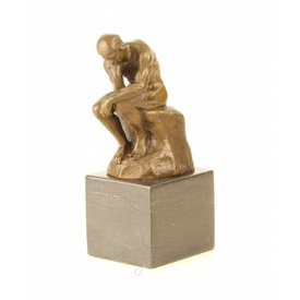 A bronze sculpture of The Thinker