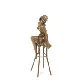 A BRONZE SCULPTURE OF A LADY ON BARCHAIR