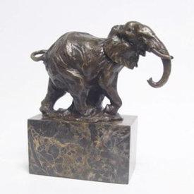 A BRONZE SCULPTURE OF A WALKING ELEPHANT
