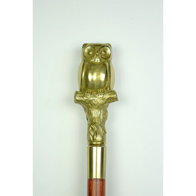 A walking stick with bronze owl grip