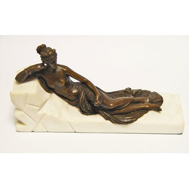 A BRONZE SCULPTURE OF A LADY AT REST