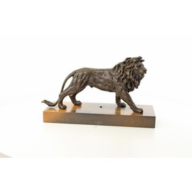 A standing lion on wooden base
