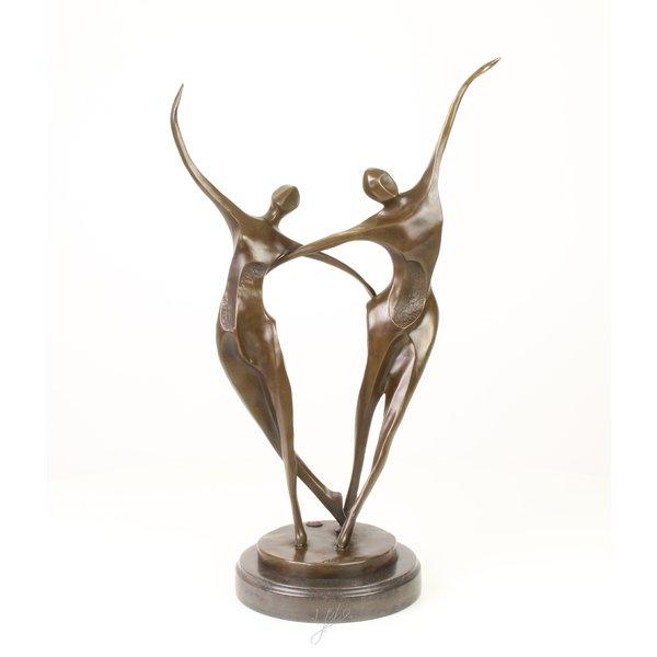 Abstract bronze sculpture of dancing couple