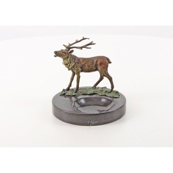 A marble ashtray mounted with a bronze deer