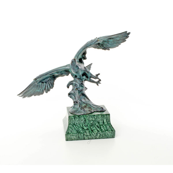 A bronze sculpture of an eagle in flight