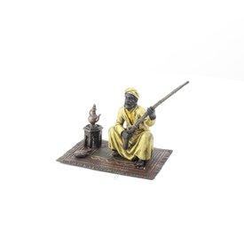 An Arab tribesman on a carpet
