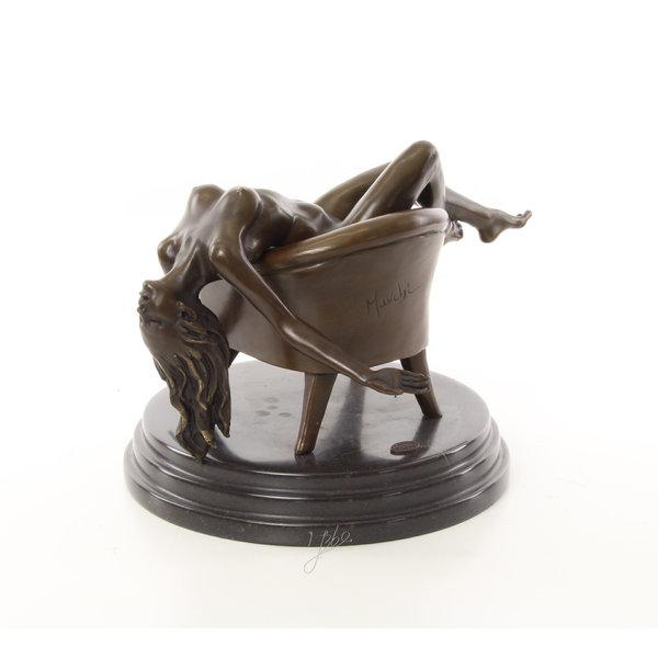 Bronze sculpture of a reclining nude female