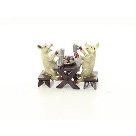 Two pigs having dinner