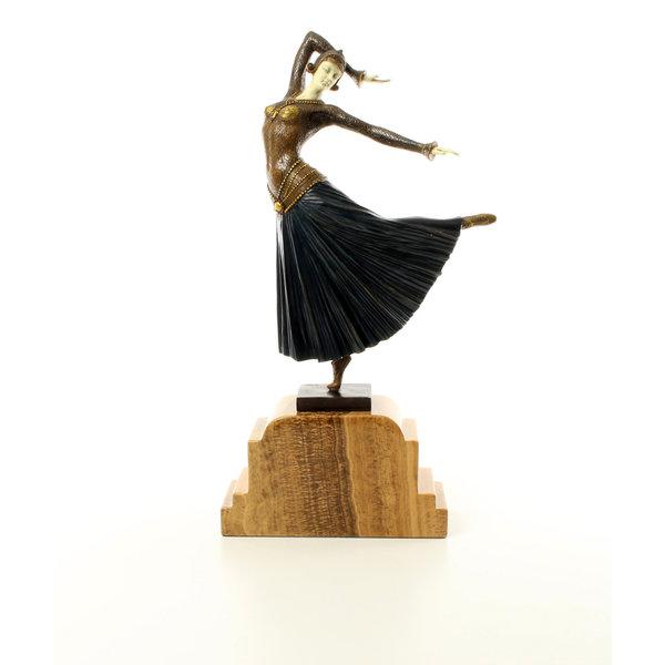 A bronze sculpture of a graceful dancing female called 'Ayouta'