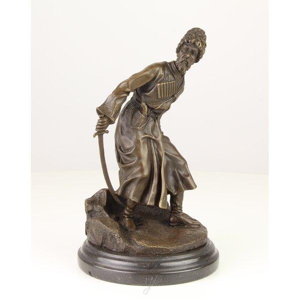 Bronze sculpture of a Cossack with sword