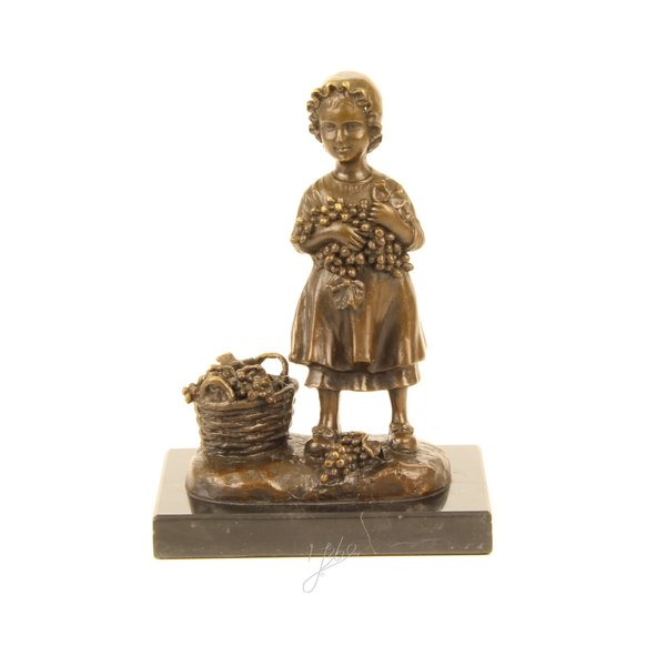 Bronze sculpture of a girl with a basket of grapes