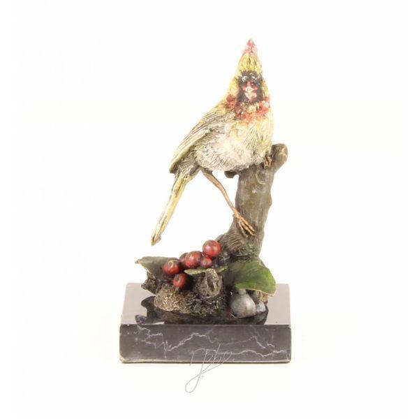 Bronzen beeld van een kardinaal vogel
