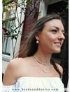 Ster Bedeltjes Ketting Van Facetglaskralen En Rocailles  - Zalm Roze Met Zilver