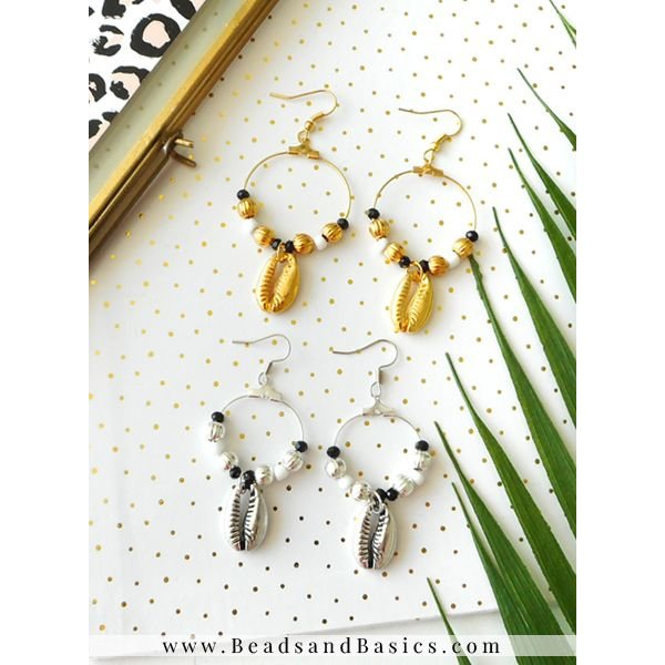 Silver And Gold Hoop Earrings With Kauri Charm
