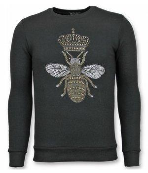 UNIMAN Rhinestone Herren Sweater - Master Bee Pullover mit Druck - Schwarz