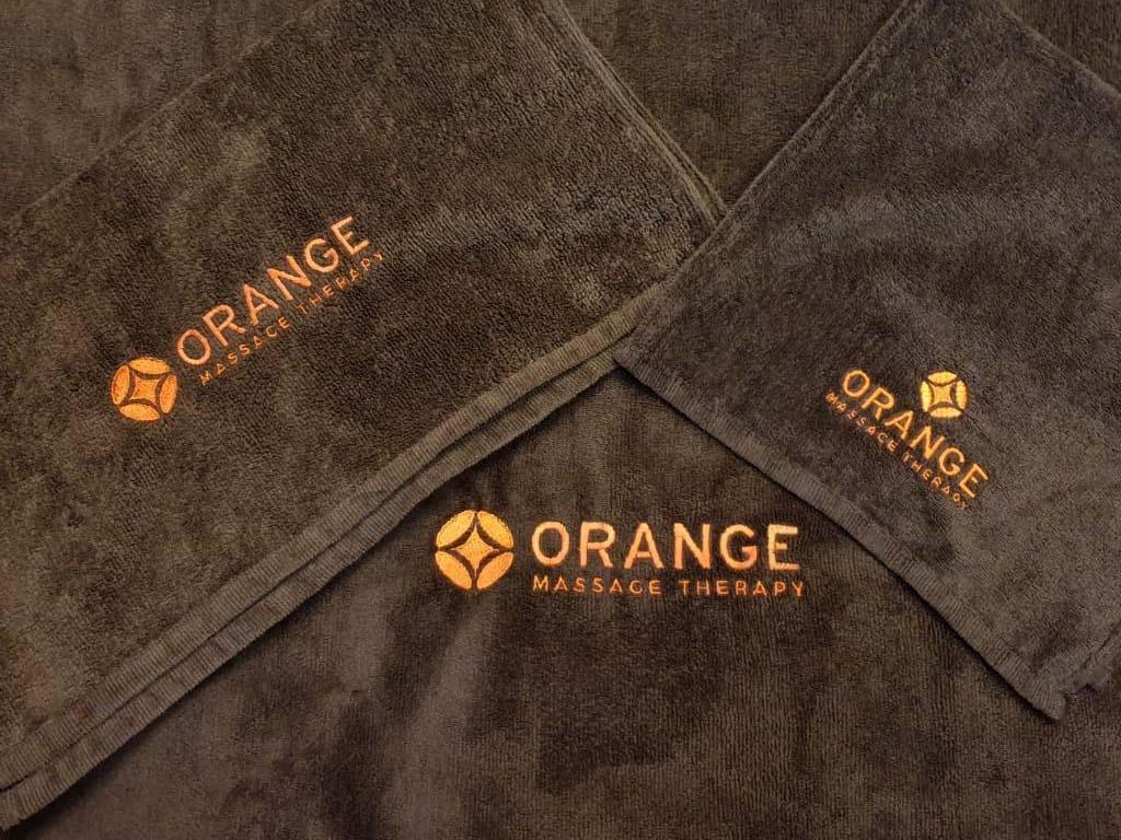 massage handdoeken borduren met logo