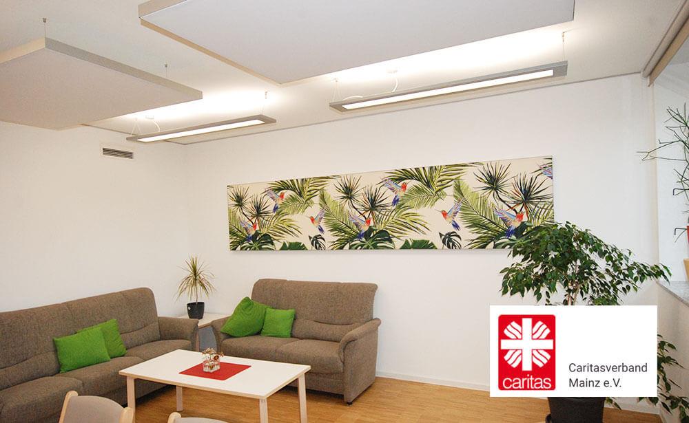 Referenzen: Moderne Wandbilder gegen Schallprobleme bei der Caritas Mainz