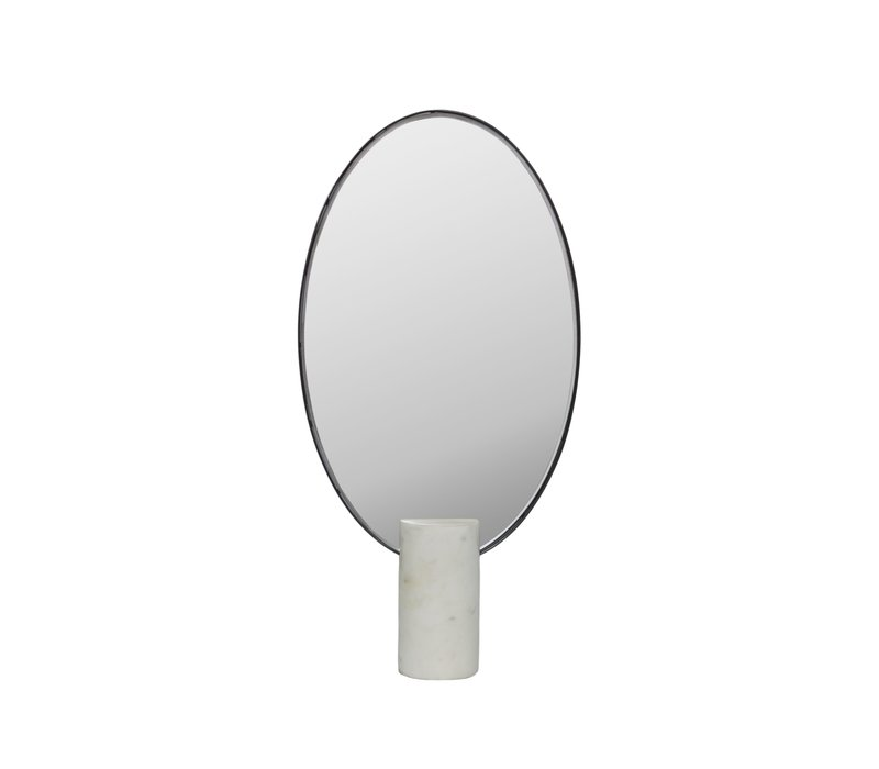 Make-up mirror oval on a white marble base