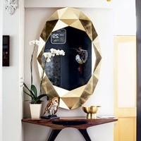 'precious' wall mirror in gold